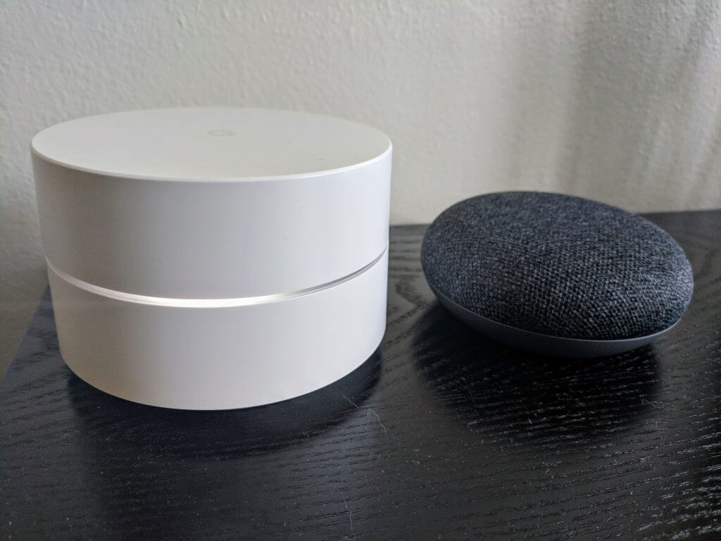 Google Home next to Google WiFi
